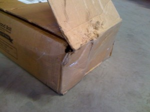 Example of a Portland Bolt box that was damaged in transit. Notice that the carrier tried to tape the boxes back together to conceal the damage.